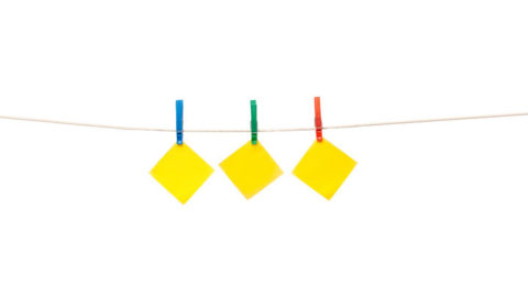 yellow notepaper hanging on clothesline